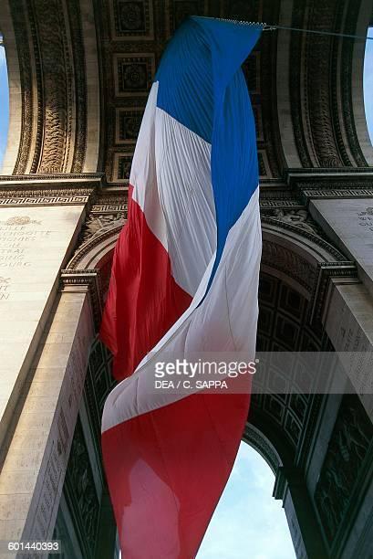 French flag under the Arch of Triumph 18061836 Paris IledeFrance France 19th century