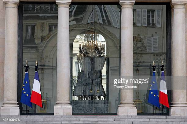 French flags are set at half mast after French president Francois Hollande declared three days of national mourning, at the Elysee Palace on November...
