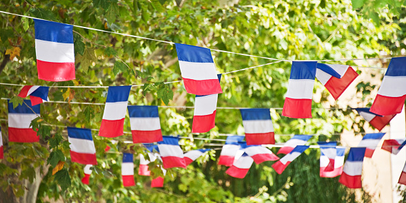 French flags garland decorating a village square 973867070
