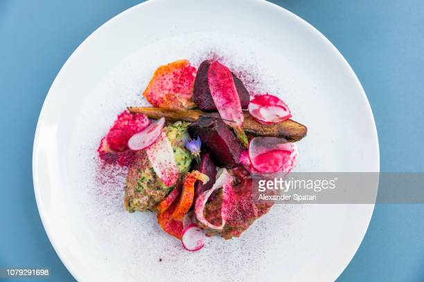 French food - appetizer with fish, beetroot, carrot, radish and potato