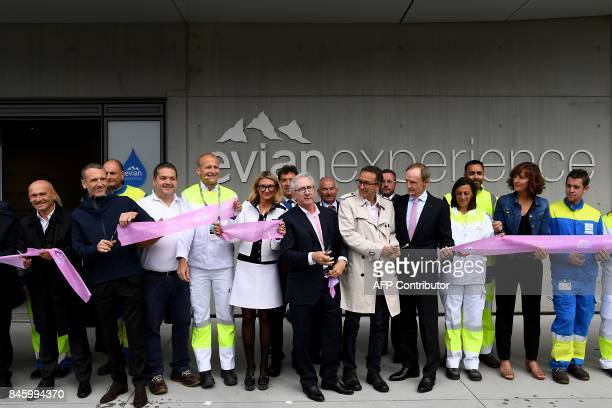 French food group Danone CEO President Franck Riboud and Danone CEO Emmanuel Faber cut the ribbon next to former French World Cup alpine ski racer...