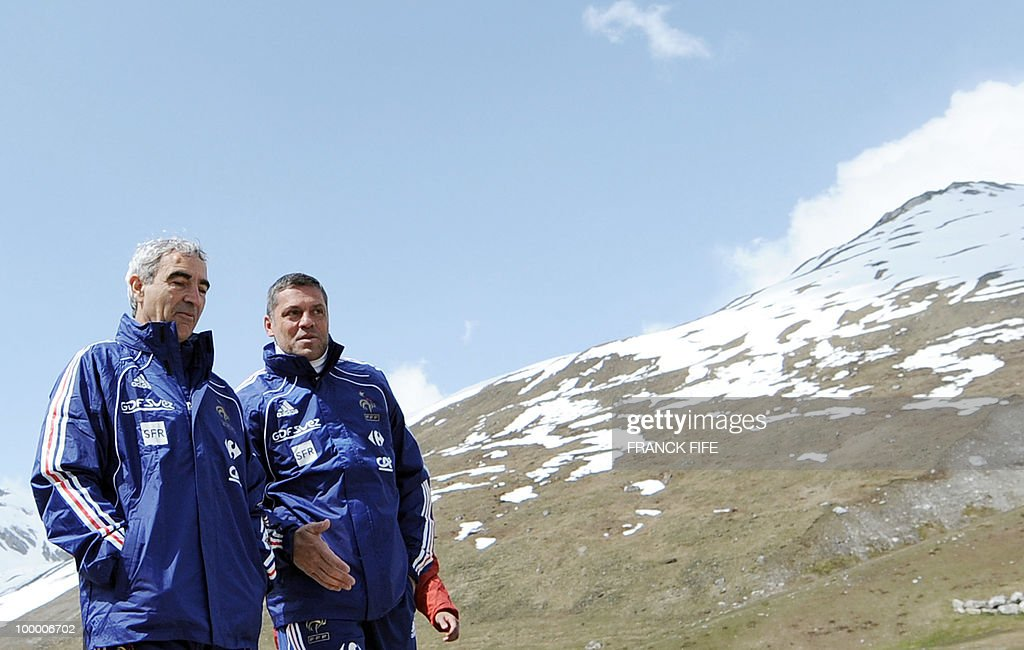 French football coach Raymond Domenech (L) chats with coach assistant Bruno Martini before a training session on May 19, 2010 in Tignes in the French Alps, as part of the preparation for the upcoming World Cup 2010. France will play Uruguay in Capetown in its group A opener match on June 11.