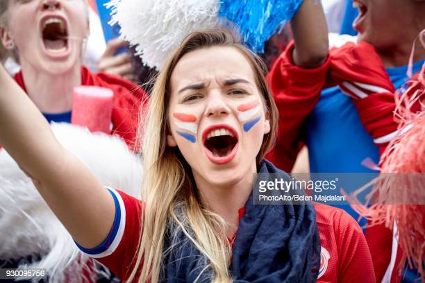 french football fan cheering at match, portrait - fan enthusiast stock photos and pictures