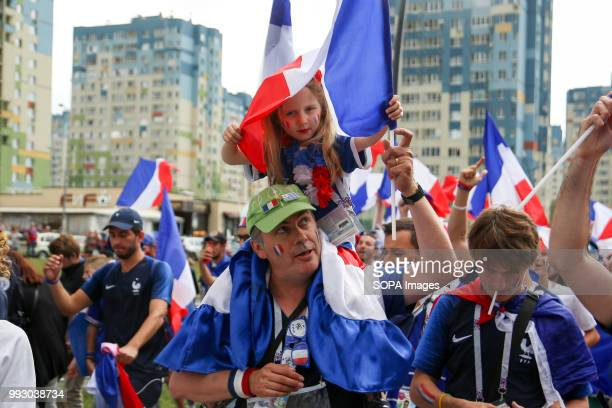 A french football fan seen celebrating with his young daughter French football fans celebrate their national football team victory over uruguay...