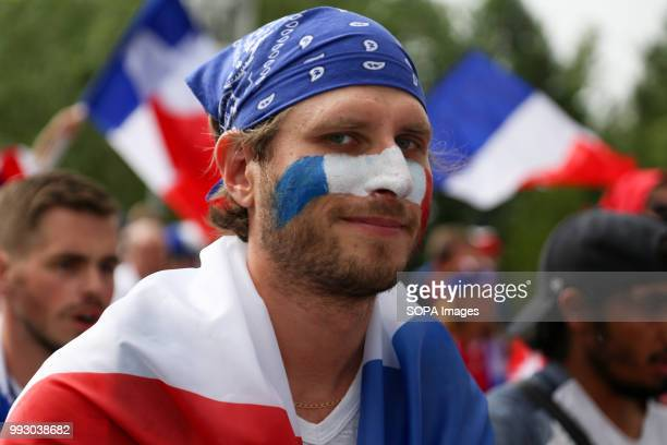 French football fan seen during the match French football fans celebrate their national football team victory over uruguay during the quarterfinal...