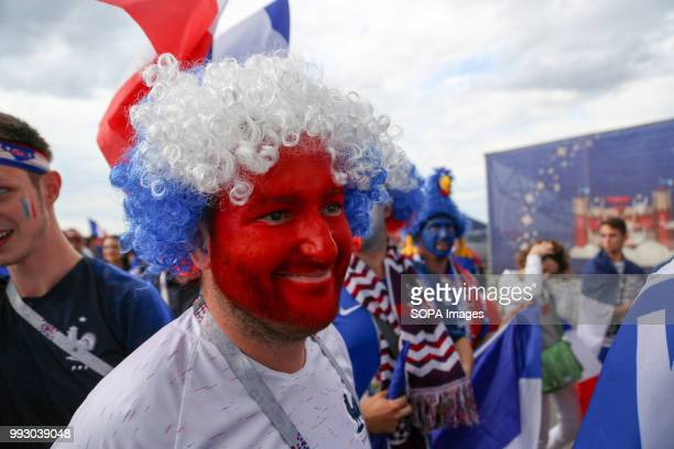 A french football fan seen have his face painted with the french national flag's colour French football fans celebrate their national football team...