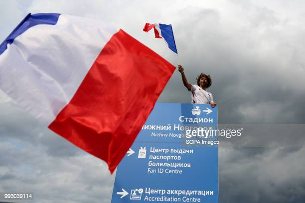 A french football fan seen holding a french national flag French football fans celebrate their national football team victory over uruguay during the...