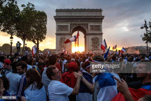 French football fans celebrate around the Arc de Triomph after France's victory against Croatia in the World Cup Final on July 15, 2018 in Paris,...