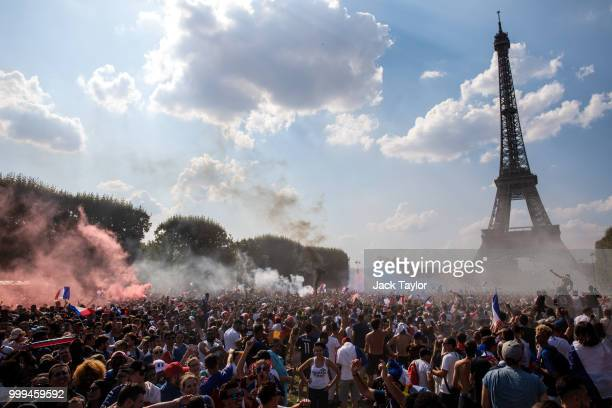French football fans celebrate in the ChampsdeMars fan zone as France score their first goal against Croatia in the FIFA 2018 World Cup Final match...
