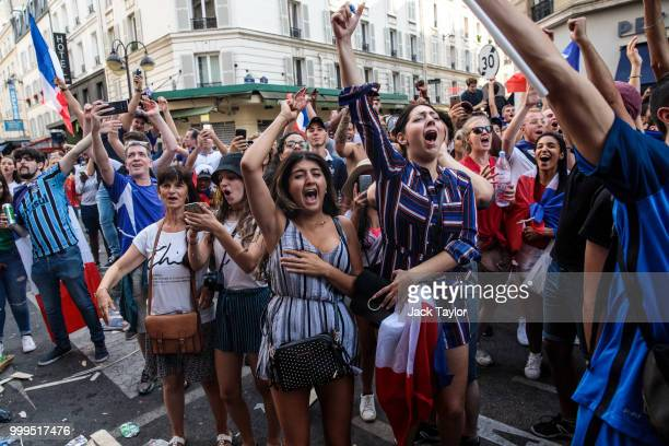French supporters watch France's victorious game against Croatia shown in a café in 2018 World Cup final on Daguerre street on July 15 2018 in Paris...