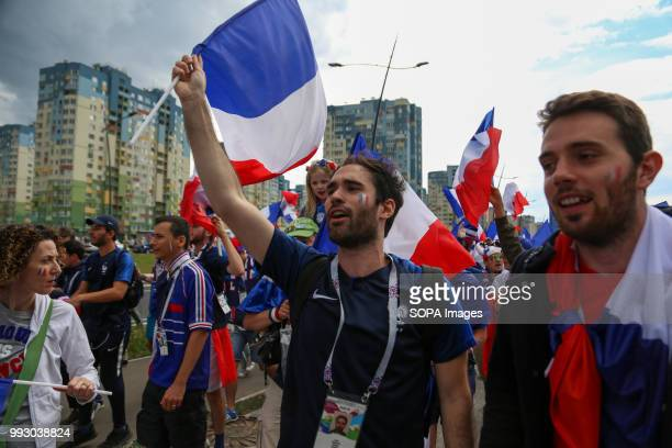 French football fans seen celebrating with their national flags French football fans celebrate their national football team victory over uruguay...