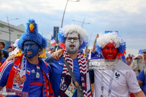 French football fans seen have his face painted with the french national flag's colour French football fans celebrate their national football team...
