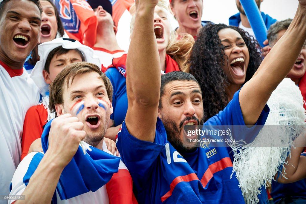 French football fans watching football match : Stock Photo