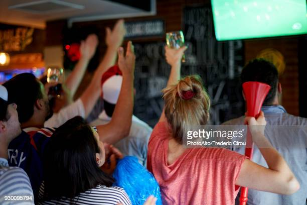 french football fans watching soccer match on television at pub - differential focus stock pictures, royalty-free photos & images