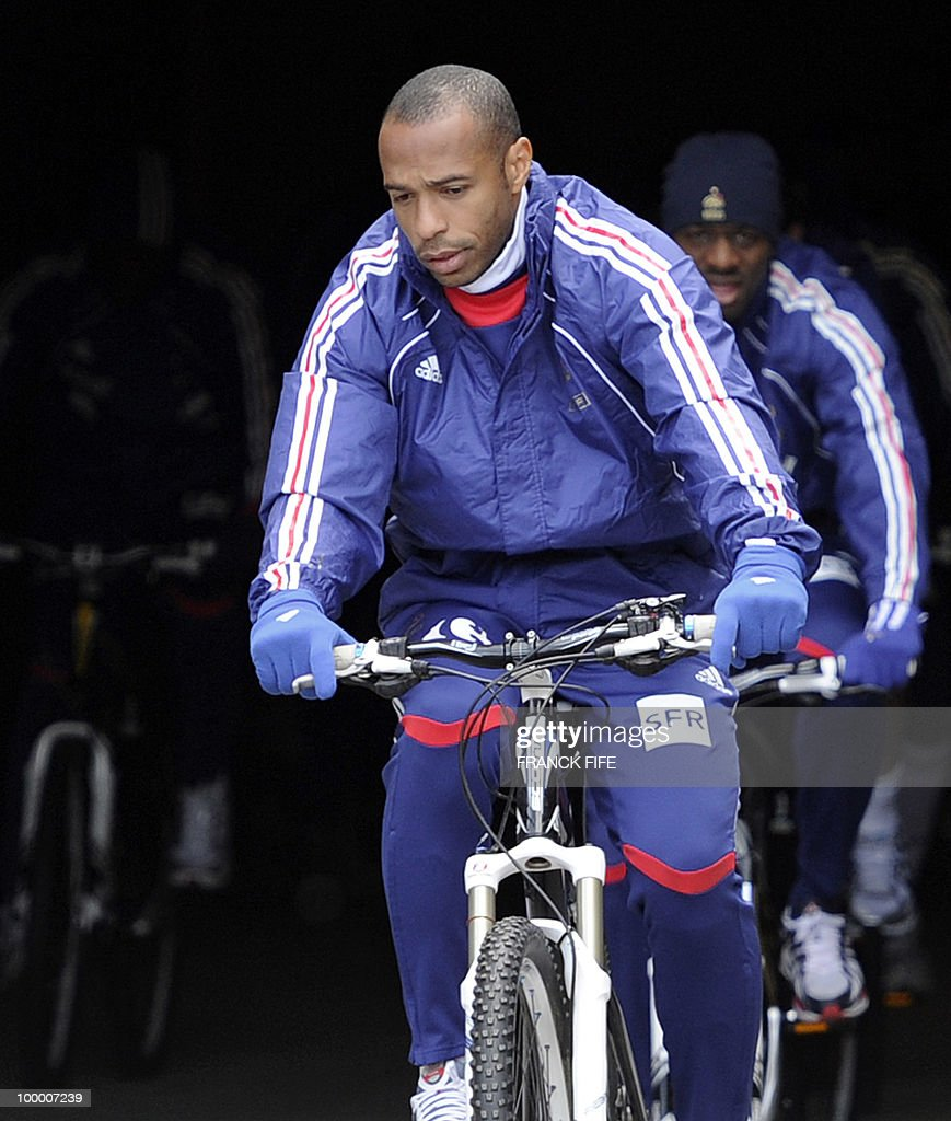 French football forward Thierry Henry leaves the hotel with teammates for a cycling training session around a lake, on May 19, 2010 in Tignes in the French Alps, as part of the preparation for the upcoming World Cup 2010. France will play Uruguay in Capetown in its group A opener match on June 11.