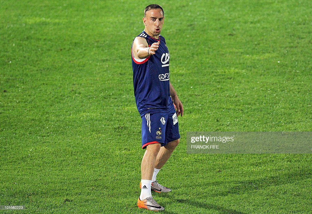 French football national team midfielder Franck Ribery adresses team-mates during a training session on June 2, 2010 at the Michel Volnay stadium in Saint-Pierre, on the French Indian Ocean island of La Reunion, as part of the preparation for the upcoming World Cup 2010. France have one remaining friendly scheduled against China in Reunion on June 4, 2010. They open their World Cup campaign against Uruguay on June 11.