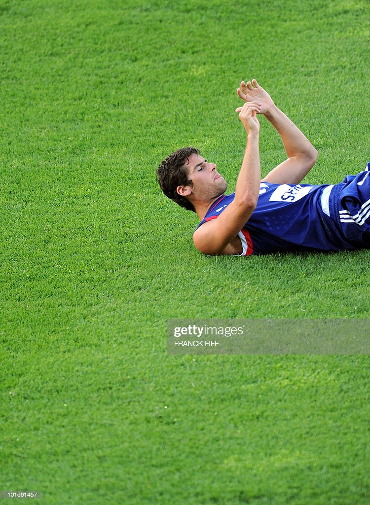 French football national team midfielder Yoann Gourcuff warms up during a training session on June 2, 2010 at the Michel Volnay stadium in Saint-Pierre, on the French Indian Ocean island of La Reunion, as part of the preparation for the upcoming World Cup 2010. France have one remaining friendly scheduled against China in Reunion on June 4, 2010. They open their World Cup campaign against Uruguay on June 11.
