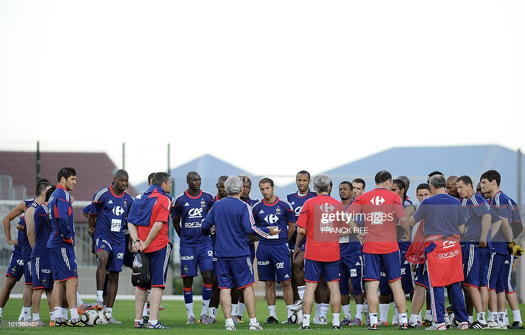 French football national team's coach Raymond Domenech (C) gives instructions to French players during a training session on June 2, 2010 at the Michel Volnay stadium in Saint-Pierre, on the French Indian Ocean island of La Reunion, as part of the preparation for the upcoming World Cup 2010. France have one remaining friendly scheduled against China in Reunion on June 4, 2010. They open their World Cup campaign against Uruguay on June 11.