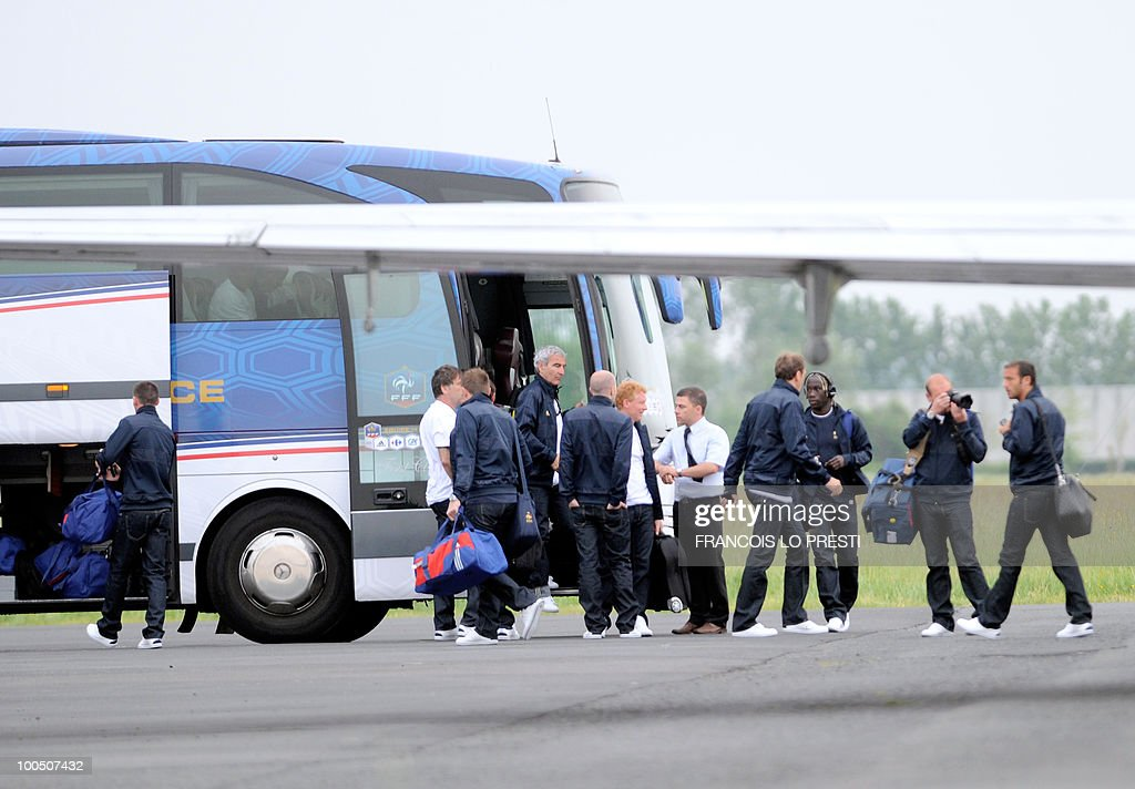 French football national team's coach Raymond Domenech (C) surrounded by French players and France staff members prepares on May 25, 2010 in the French northern city of Valenciennes to get in a bus heading to Lens where France is to play against Costa-Rica for a friendly game, on May 26, 2010. Domenech revealed a 23-man squad for the upcoming 2010 World Cup which included the Arsenal defender William Gallas who is recovering from a calf injury, however the Frenchman said that until June 1 - when all federations must submit their final teams to FIFA - nothing was definitive.