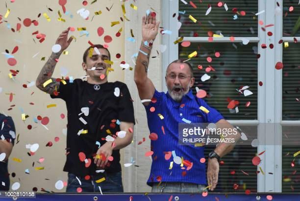 French football player Antoine Griezmann and his father Alain greet fans in his hometown of Macon eastern France on July 20 after French players won...