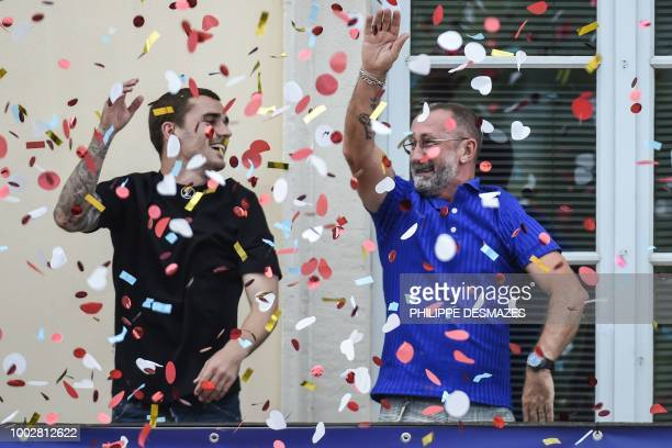 French football player Antoine Griezmann and his father Alain greet fans in his hometown of Macon eastern France on July 20 2018 after France won the...