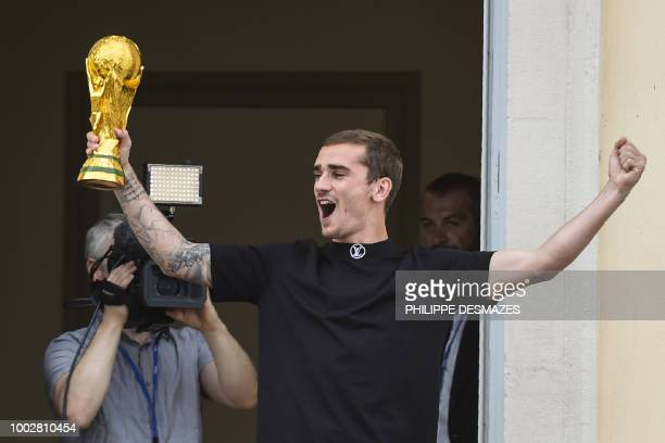 TOPSHOT French football player Antoine Griezmann greets fans in his hometown of Macon eastern France on July 20 after French players won the Russia...