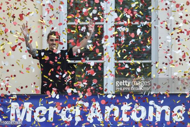 French football player Antoine Griezmann stands behind a banner reading Thank You Antoine as he greets fans in his hometown of Macon eastern France...