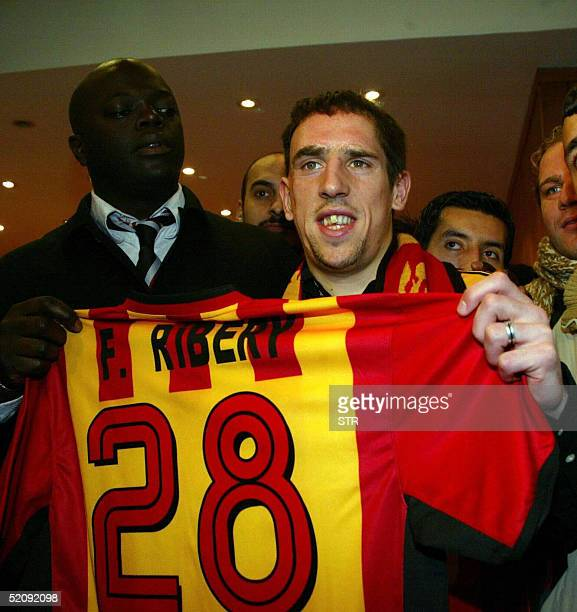 French football player Franck Ribery poses with his Galatasaray jersey after signing up with the club in Istanbul 01 February 2005. The club's...