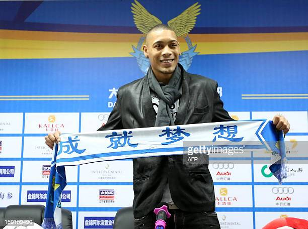 French football player Guillaume Hoarau attends a press conference held by Dalian Aerbin club in Dalian northeast China's Liaoning province on...