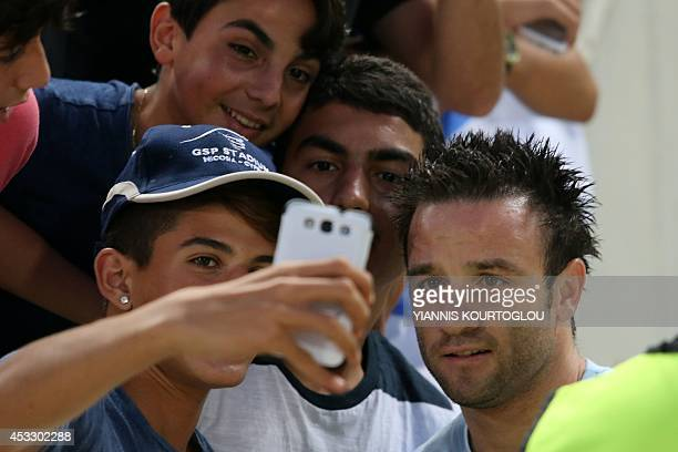 French football player Mathieu Valbuena of Russian club Dynamo Moskva poses for a picture with fans during their UEFA Europa League third qualifying...