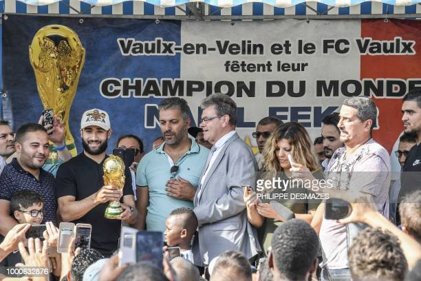 French football player Nabil Fekir celebrates as he holds the trophy in his home town of Vaulx-en-Velin near Lyon, southeastern France on July 17 two...