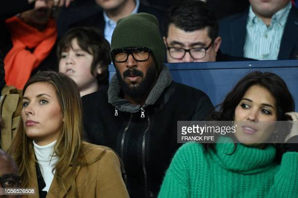 French football player Nicolas Anelka attends the French L1 football match between Paris SaintGermain and Lille at the Parc des Princes stadium in...