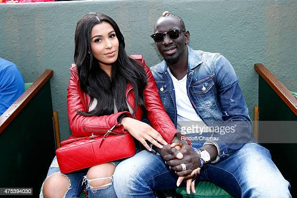French Football player of Liverpool Mamadou Sakho and his companion Matja attend the 2015 Roland Garros French Tennis Open Day Eight on May 31 2015...