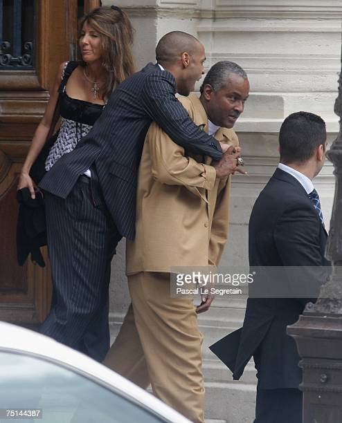 French Football player Thierry Henri jumps on Tony Parker's father as they leave Paris town hall after the wedding between Eva Longoria and Tony...