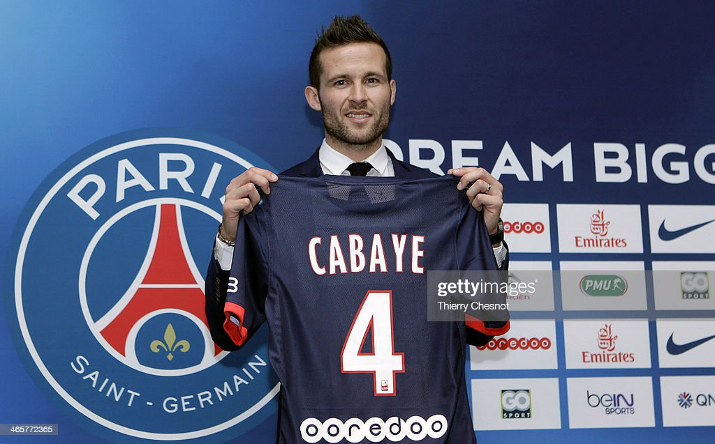 French football player Yohan Cabaye poses with his new club shirt during a press conference after completing a transfer from Newcastle United to Paris St Germain, at the Parc des Princes stadium on January 29, 2014 in Paris, France.