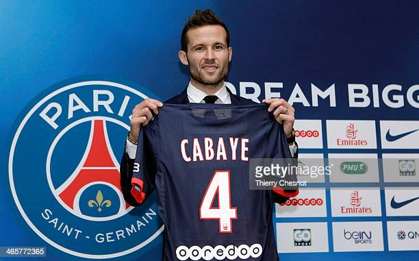 French football player Yohan Cabaye poses with his new club shirt during a press conference after completing a transfer from Newcastle United to...