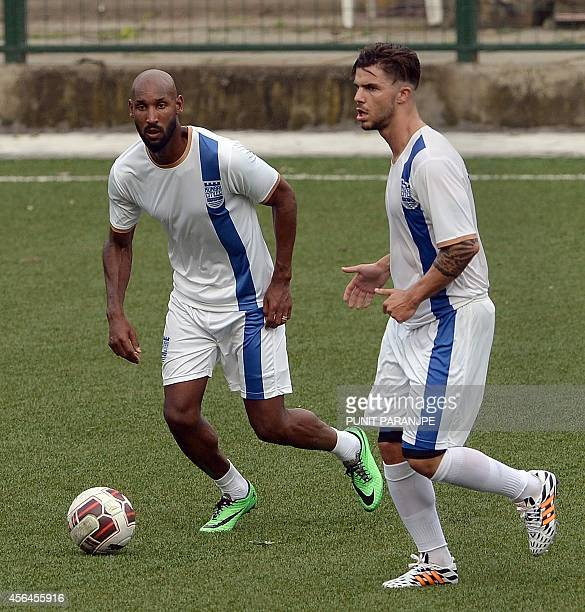 French football striker Nicolas Anelka participates in a training session of Mumbai City Football Club team at Cooperage Ground in Mumbai on October...