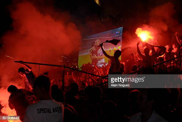 French football supporters light flares in the stands in Parc des Princes after their team's 10 victory in the FIFA World Cup semifinals against...