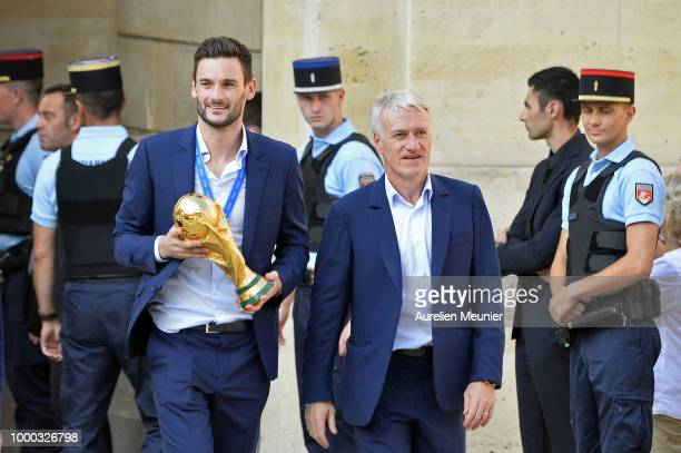 French football team captain Hugo Lloris and France head coach didier Deschamps arrive as French President Emmanuel Macron receives the France...