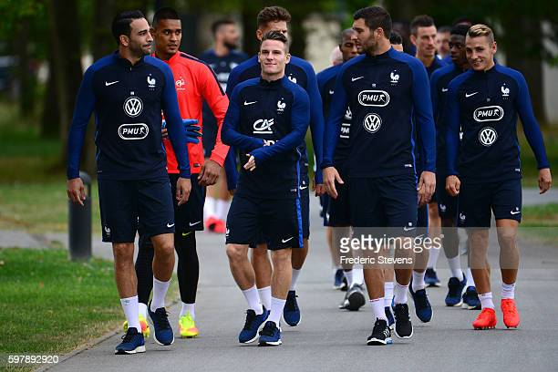 French Football Team defender Adil Rami forward Kevin Gameiro and forward AndrePierre Gignac arrive a training session on August 29 2016 in...