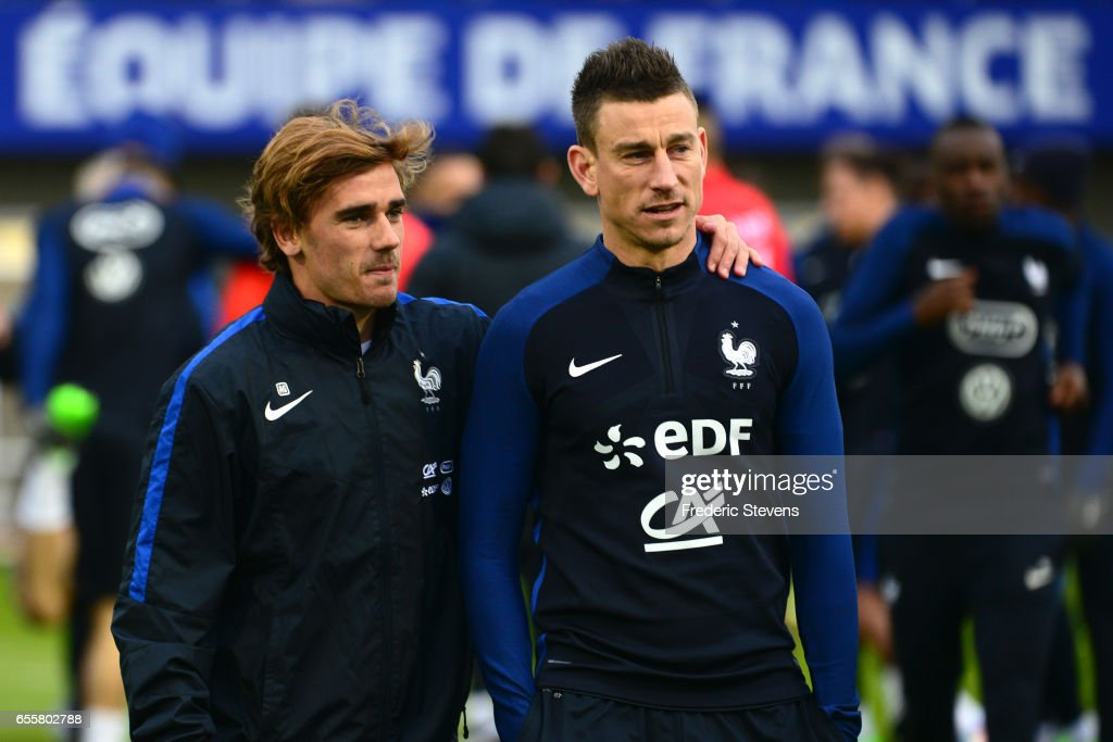 French Football Team forward Antoine Griezmann (L) and defender Laurent Koscielny (R)during the training session on March 20, 2017 in Clairefontaine, France. The training session comes before the upcoming qualifying match against Luxembourg next saturday for the 2018 World Cup.