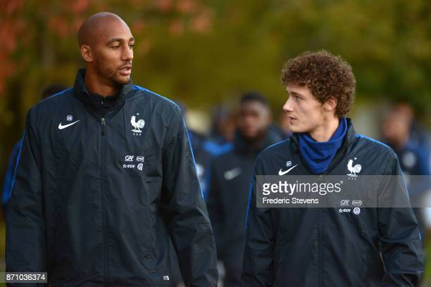 French Football Team mifielder Steven Nzonzi and forward Benjamin Pavard arrive for the training session on November 6 2017 in Clairefontaine France...