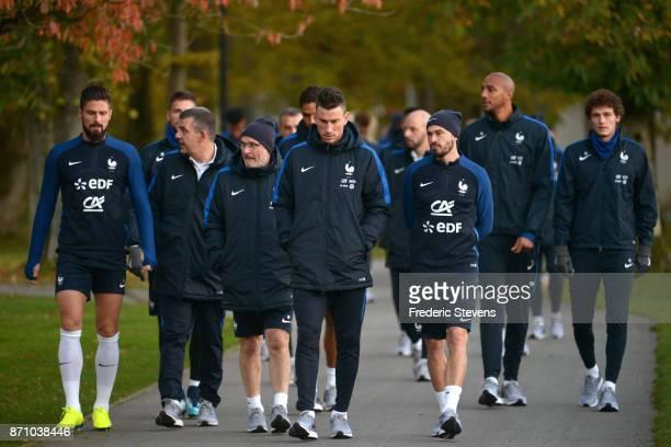 French Football Team Olivier Giroud Laurent Koscielny Christophe Jallet arrive for the training session on November 6 2017 in Clairefontaine France...