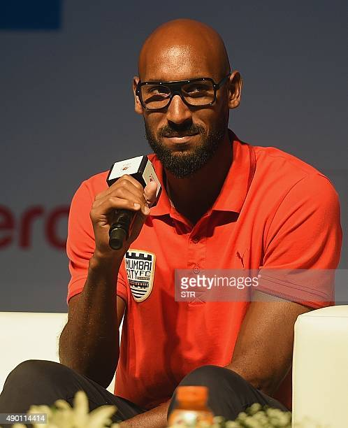 French footballer and Mumbai City FC coach Nicolas Anelka listens during the media interaction session for the Indian Super League football...