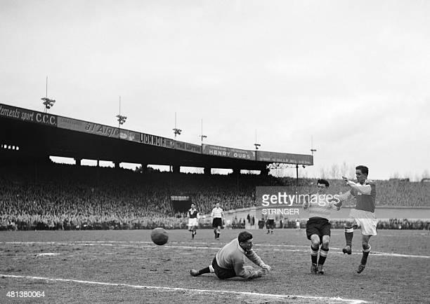French footballer Raymond Kopa of Stade de Reims fights the ball with Henri Arnaudeau of Football Club des Girondins de Bordeaux on February 23, 1953...