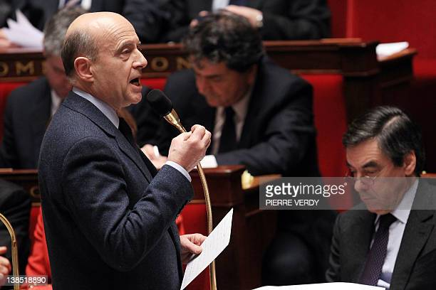 French Foreign Affairs minister Alain Juppé delivers a speech during the weekly session of questions to the government at the National Assembly on...