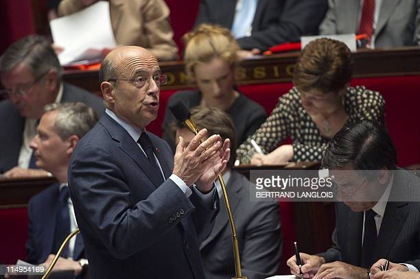 French Foreign Affairs minister Alain Juppe adresses the deputies during a session of questions at the National Assembly on May 31 2011 in Paris AFP...