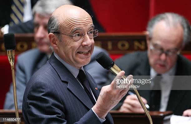 French Foreign Affairs minister Alain Juppe adresses the deputies during the weekly session of questions at the National Assembly on May 25 2011 in...