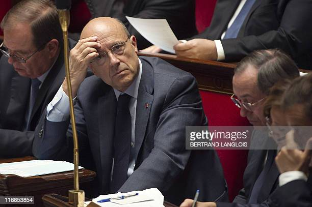 French Foreign Affairs minister Alain Juppe looks on as he attends the session of questions at the National Assembly on May 31 2011 in Paris AFP...