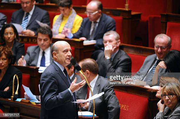 French Foreign Affairs Minister Alain Juppe speaks during the weekly session of questions to the government on December 13 2011 at French National...